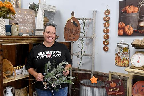 Beth Caldwell stands among her fall decor pieces in her new store Cinnamon Hearts decor and Sun Kissed Tanning in Hampton. News-Register/Jeni Moellenberndt