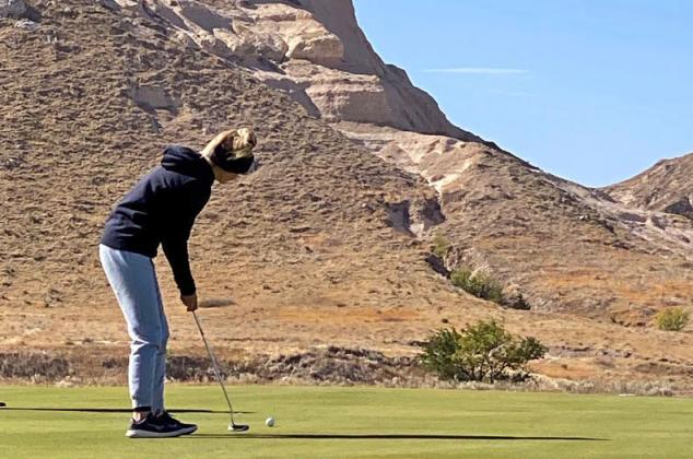 (Photo courtesy of Adam Darbro) Aurora senior Riley Darbro putts the ball during last week's Class B State Golf Tournament, played at the scenic Monument Shadows Golf Course in Gering.