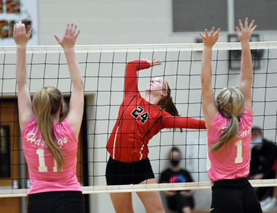 Raina Cattau splits the Hastings defense during a four-set win over the Tigers Thursday.