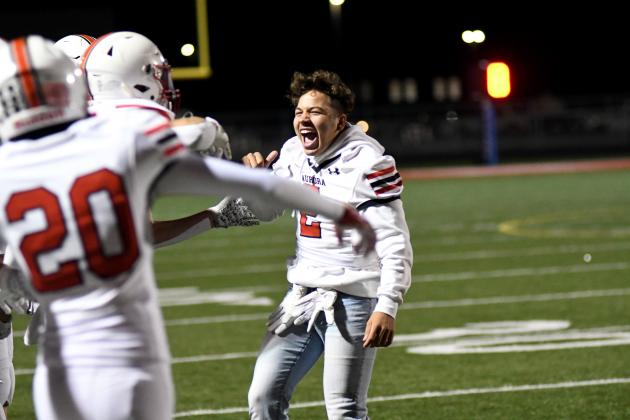 Carlos Collazo (2) celebrates with his teammates after the Huskies defeated Norris on the road Friday night.
