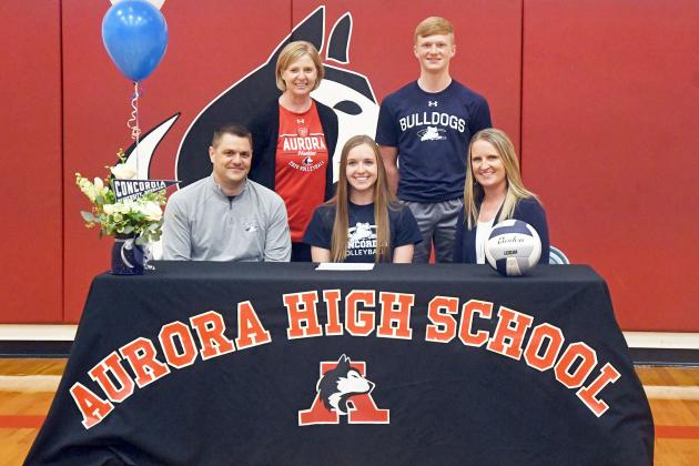 Cassidy Knust signed her letter of intent with Concordia University with her parents, Troy and Cami as well as brother Drew and Aurora coach Lois Hixson.