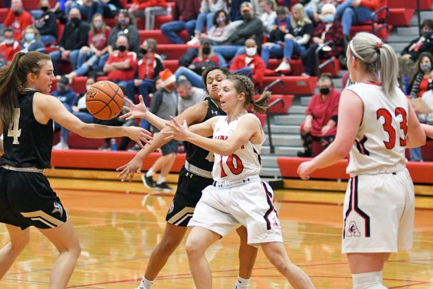 Brooklyn Moody battles for the basketball between two Grand Island Northwest defenders during Aurora's 50-31 loss to the Vikings.