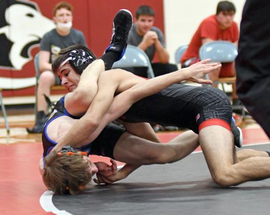Aurora's Jeremy Oswald won two matches as part of his senior night Thursday.