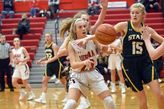 Aurora's Delaney Nachtigal fights for a loose ball on the offensive end during the second half of Aurora's 38-31 win.