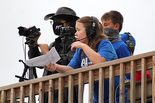 Courtesy photo // Nathan Ertzner (left) and Sarah Person work together to capture both audio and video during an HPC football broadcast last fall.