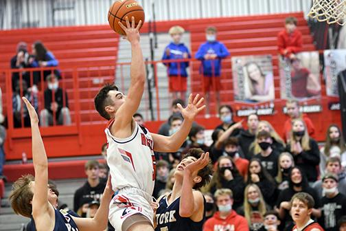 Aurora's Jameson Herzberg scored 17 of his 19 points in the second half of the Huskies' 45-43 win against York Monday night.