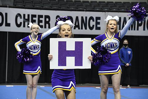 Senior Lexie Wolinski, front, leads a chant with help from cheer teammates Kennedy McCullough, left, and Kaylei Joseph.