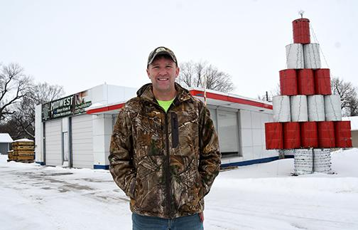 Eric Joseph stands in front of the Highway 34 structure where he currently bases his Midwest Spray Foam business. Joseph is planning to tear down the former gas station when the weather allows and build a new structure in its place.