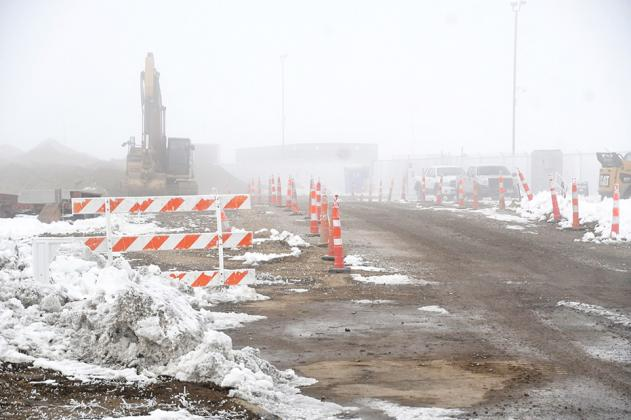 Though barely visible this week due to the snow and heavy fog, crews are making progress on the Madison Avenue extension project, where they are completing installation of water and sewer infrastructure.
