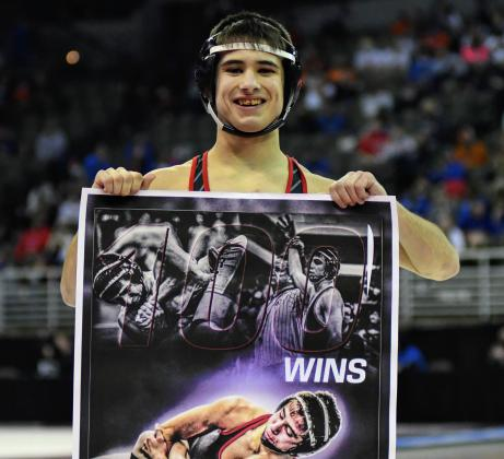 Jeremy Oswald won his 100th career match during the opening round of the state wrestling championships.