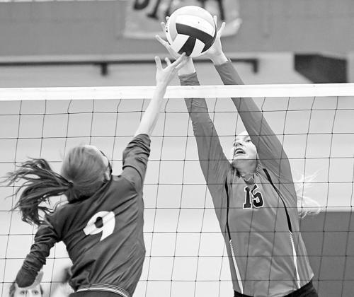 Lexi Jones was a force at the net for Aurora, rejecting eight shots from Wahoo over the course of the three-game set. News-Register/Richard Rhoden