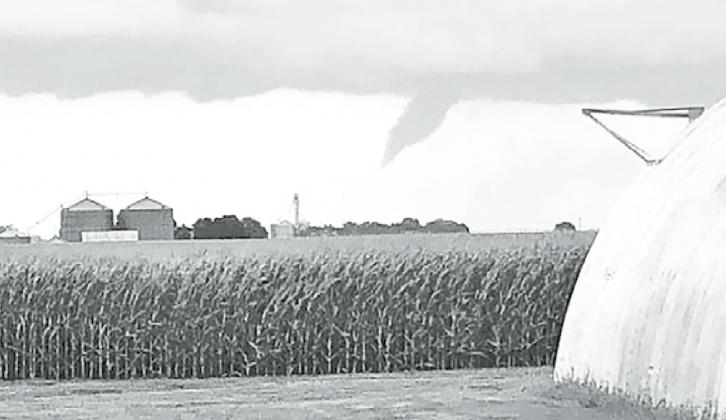 A funnel cloud forming near Hampton was photographed by Tessa Glinsmann. Her family's acreage suffered damages from the Friday night storm. Courtesy photo