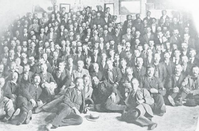 The charter organization of Douglas Castle No.1, in Aurora. This flash-light picture was taken after the official organization of the Royal Highlanders on Aug. 11, 1896. Photo courtesy of the Plainsman Museum