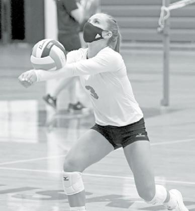 Cassidy Knust wears a mask during volleyball practice last week, something the team, led by the seniors, decided to do. News-Register/Richard Rhoden
