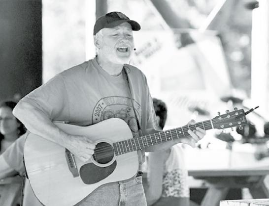 Lincoln musician Paul Siebert roamed the crowd while performing Saturday night in Stockham. News-Register/Kurt Johnson