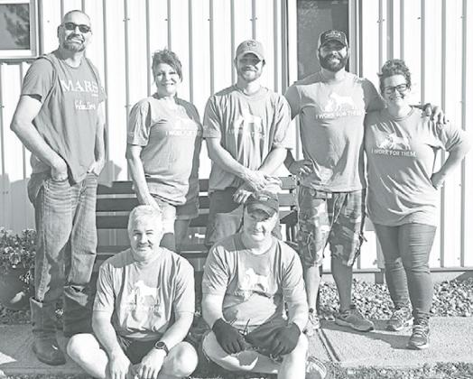 Volunteers from Mars Petcare include front from left: Kirk Hoeffner and Carlin Engert. Back row from left: Dusty Neville, Teresa White, Cody Ratkovec, Cody Buhrman and Leanna Smith. News-Register/Jeni Moellenberndt